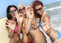 Group of beautiful escort guides on Punta Cana beach