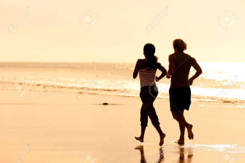 Couple jogging on beach to improve sex life